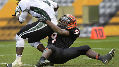 Clairton Bear Robert Boatright takes down Sto-Rox quarterback Lenny Williams Friday at Heinz Field.