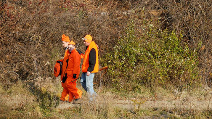 Braydon Haun, Cory Tetzlaw and Mike Schmitt, all of Brighton Heights, walk out of the State Game Lands along Route 22 near Florence and Star Lake in Washington back toward their car for a break late this morning. Mr. Schmitt said they will hunt for deer till dark.