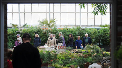 Guest tour the South Conservatory garden railroad, which shows plants arriving at Phipps from the Columbian Exposition  of 1893 in Chicago.