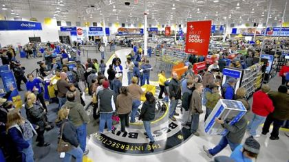 Shoppers crowd a Best Buy store on Black Friday in Peoria, Ill.