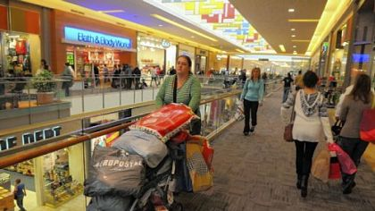 Deb Castro of Woodbridge, Va., pushes a stroller loaded with shopping items that she and her three sisters bought Friday at the Mall at Robinson.