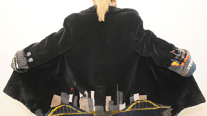 A fur coat with the Pittsburgh skyline on the back and the two stadiums on the sleeves for sale at Carl W. Herrmann Furs.
