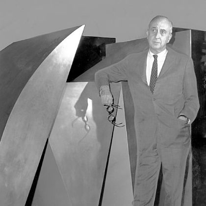 "In September 1969, Carnegie Musuem director Leon Arkus ponders details of coming exhibition beside the Duayne Hatchett sculpture ""Blue Parallel,"" purchased from the 1967 International."