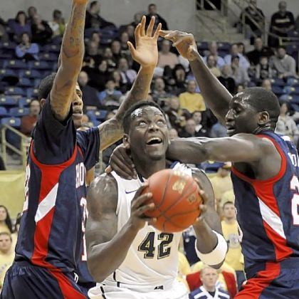 Howard&#039;s Theodore Boyomo, right, grabs Talib Zanna. Zanna contributed 12 points and eight rebounds.