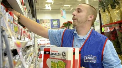 Assistant store manager Joshua Steele stocks the last of the 100-watt incandescent bulb inventory Tuesday at Lowe's Home Improvement on Waterfront Drive in Munhall.