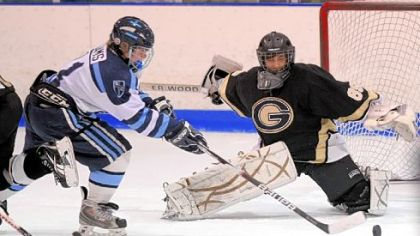 Bishop Canevin's Blaine Adams fires a shot at Gateway goalie Tyler Perhac during a PIHL Class AA game last season.