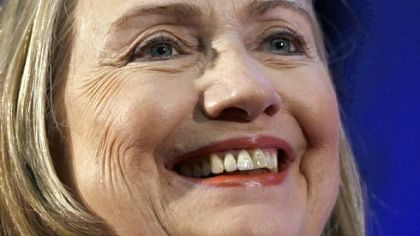 Secretary of State Hillary Rodham Clinton smiles as she waits to speak at Singapore Management University in Singapore last Saturday.