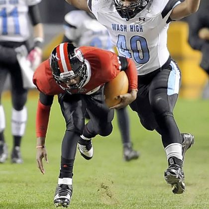 Aliquippa's Malik Shegog stumbles ahead for more yardage with Washington's Jaylin Kelly in hot pursuit.