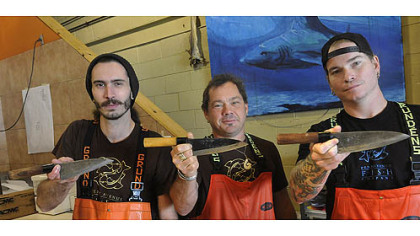 Kyle Houghtelin, Henry Dewey and Tim Reynolds flash their personal deba knives at neighboring Penn Avenue Fish Co.