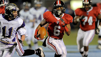 Aliquippa's Dravon Henry runs the ball against Karns City Friday night at Central Valley High School.