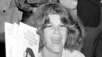 In this September 1982 photo, actress Gilda Radner holds up copies of her books at a New York bookstore.