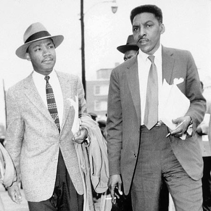 Bayard Rustin, right, walks with Martin Luther King, Jr., in this 1956 file photo.