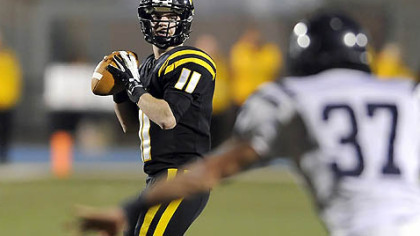 North Allegheny quarterback Mack Leftwich drops back to pass Friday night in the big PIAA victory against McDowell.