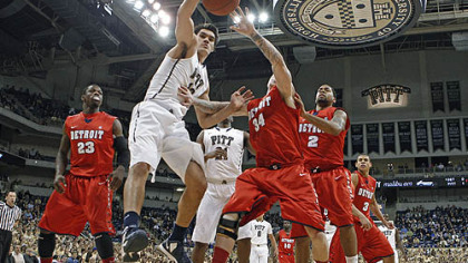 Pittsburgh's Steven Adams (13) goes for a rebound with Detroit's Nick Minnerath (34) in the first half.