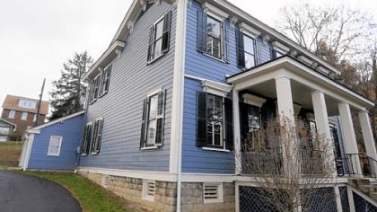This three-bedroom house in Spring Hill, built in 1867, has been completely restored. It is on the market for $239,900.