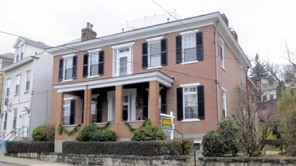 The four-bedroom home, which was built in 1855, has nine fireplaces and original woodwork. It is on the market for $298,900.