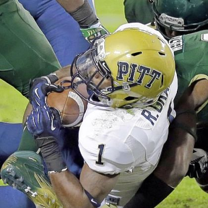 Ray Graham dives into the end zone to score Pitt's first touchdown Saturday night in what became a 27-3 win against South Florida in Tampa.