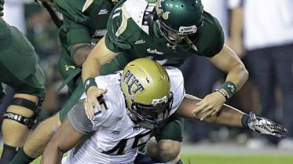 Pittsburgh defensive lineman Shayne Hale (45) and South Florida quarterback Matt Floyd (11) reach for a fumble by Floyd in the first quarter.
