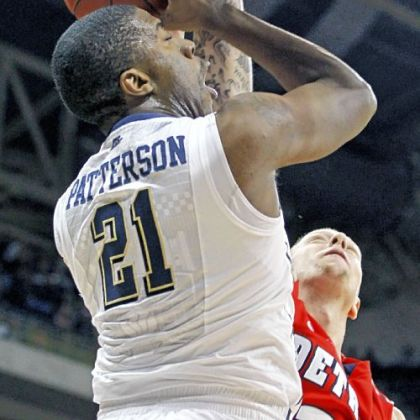 Lamar Patterson has a shot blocked by Detroit's Nick Minnerath in the first half Saturday night.