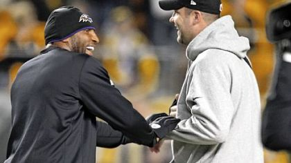 Injured veterans Ray Lewis, left, and Ben Roethlisberger meet before the game.