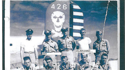 Andrew Rausch (front row, second from left) with his B-24 crew mates, including Carrick's Walter Sankey (front, second from right). The crew perished in a crash in the Philippines on Jan. 10, 1945.