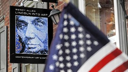 An art gallery on Baltimore Street in Gettysburg displays a flag from 1863.