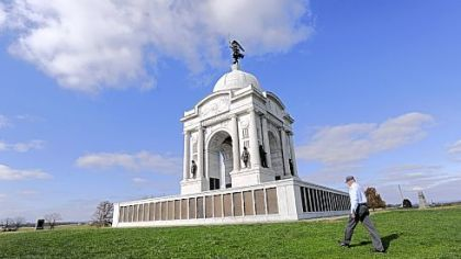 Licensed battlefield guide Paul Marhevka walks past the Pennsylvania Monument on the Gettysburg battlefield.