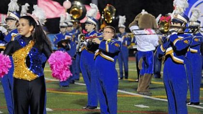 Andrew Duch, center, who has autism, performs with the Hampton High School marching band at a football game in October.
