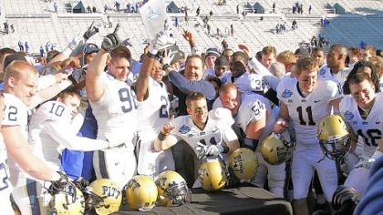 In the 2011 BBVA Compass Bowl, then-interim Pitt coach Phil Bennett, center, celebrates with players after they beat Kentucky, 27-10, in Birmingham, Ala.