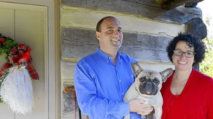 John and Mohylyn Yocca, with their French bulldog, Bruno. The Yoccas bought a 15-foot tree, instead of their usual 12-foot tree, when they spruced up their home for the watchful Shepard House Tour.