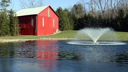 The barn and pond on the property.