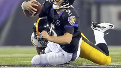 Steelers' Ziggy Hood takes down Ravens quarterback Joe Flacco in the third quarter Sunday in Baltimore.