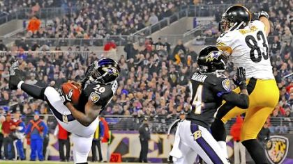 Ravens safety Ed Reed intercepts a pass intended for Heath Miller in the end zone in the fourth quarter Sunday in Baltimore.
