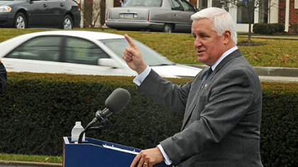 Gov. Tom Corbett talks at the ribbon-cutting ceremony at the reopening of Route 19, the Wexford Flats.