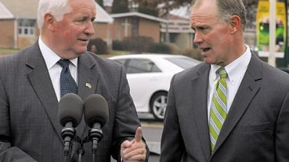 Gov. Tom Corbett and Rep. Mike Turzai talk after a ceremony to mark the completion of construction work on Route 19 in McCandless on Monday.
