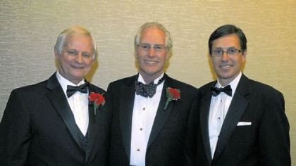 YMCA CEO Rigg Riggins, honoree Clifford Rowe Jr., and Robert Cottington.