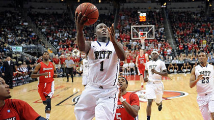 Pitt point guard Tray Woodall drives to the net against Duquesne in the second half of the City Game at Consol Energy Center.