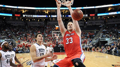 Duquesne&#039;s Martins Abele dunks in front of Pitt&#039;s Steven Adams in the first half of the City Game Wednesday at Consol Energy Center.