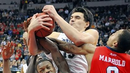 Pitt's Steven Adams fights for a rebound against Duquesne's Derrick Colter, left, and Andre Marhold in the second half of the annual City Game Wednesday night at Consol Energy Center.