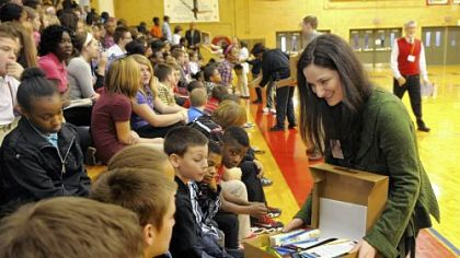"Katherine Harrell shows students in the McKeesport Area School District the items in the ""briefcases."""