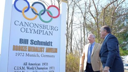 Canonsburg Mayor Dave Rhome, left, and honoree Bill Schmidt, who won a bronze medal in the 1972 Olympics in Munich, unveil a landmark in recognition of the 40th anniversary on Saturday.