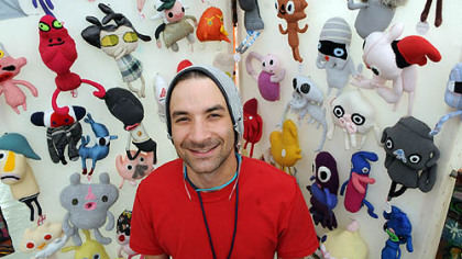 Daniel Baxter, creator of Kreepy Dolls, poses with his creations at the 2012Three Rivers Arts Festival.