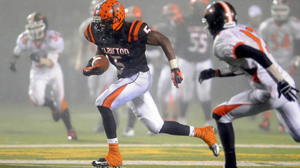 Clairton's Terrish Webb carries for a touchdown against Port Allegany in the PIAA semifinal Friday night.