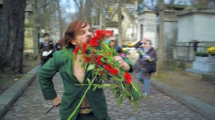 "In ""Holy Motors,"" Denis Lavant is brilliant in the various roles of Monsieur Oscar, including one in which he eats the flowers he has taken from headstones in a Paris cemetery."