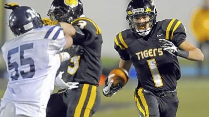 North Allegheny's Brendan Coniker carries back an interception against McDowell in the PIAA quarterfinals last Friday.
