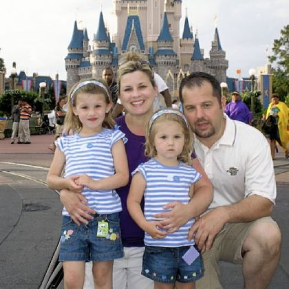Carrie Goretzka with husband, Michael, and daughters Chloe, left, then 4, and Carlie, then 2, at Disney World in 2009.
