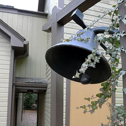A bell sits near the breezeway that connects the family room to the media room.