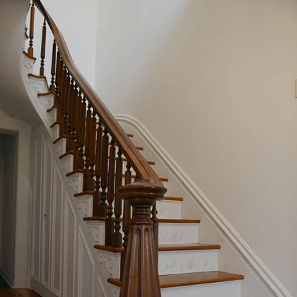 Upon entering the 17- by 7-foot foyer, the visitor notices a grand staircase and hardwood floors that run throughout the house.