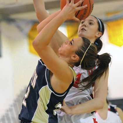 Norwin's Rachel Dellefemine, left, has her shot blocked by Shaler's Andrea Lydon, right, in season-opening action at Penn-Trafford High School.