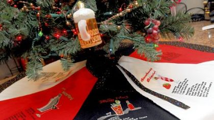 Carol Johnson made a tree skirt with drink recipes for the rec room bar.